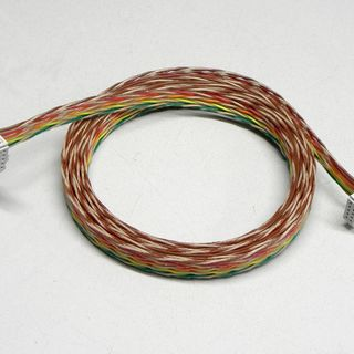 Spliced ribbon cable with strain relief